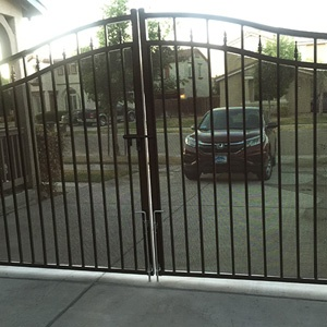 wrought iron gate at end of driveway