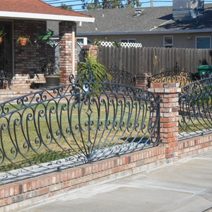 wrought iron fence with bricks