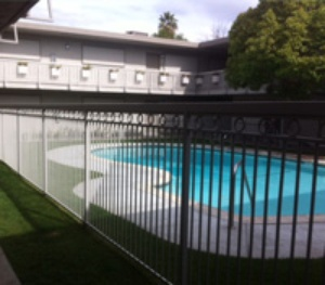 iron fence and gate around pool area
